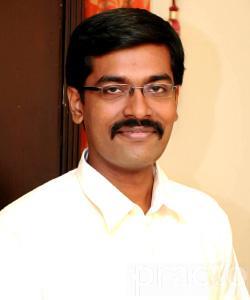 Dr. Raghu - Dentist