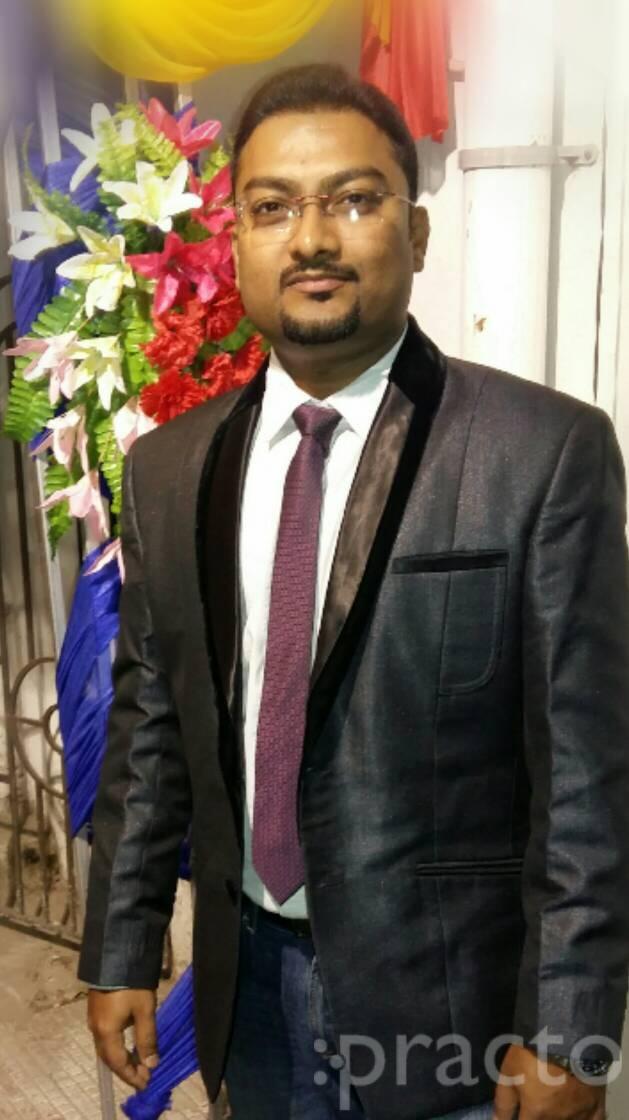 Dr. Rajat Majumder - Dentist