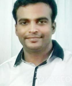 Dr. Rajesh Divakaran - Dentist