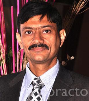 Dr. Rakesh Thaper - Dentist