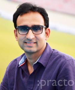 Dr. Ravindra Dhariwal - Dentist
