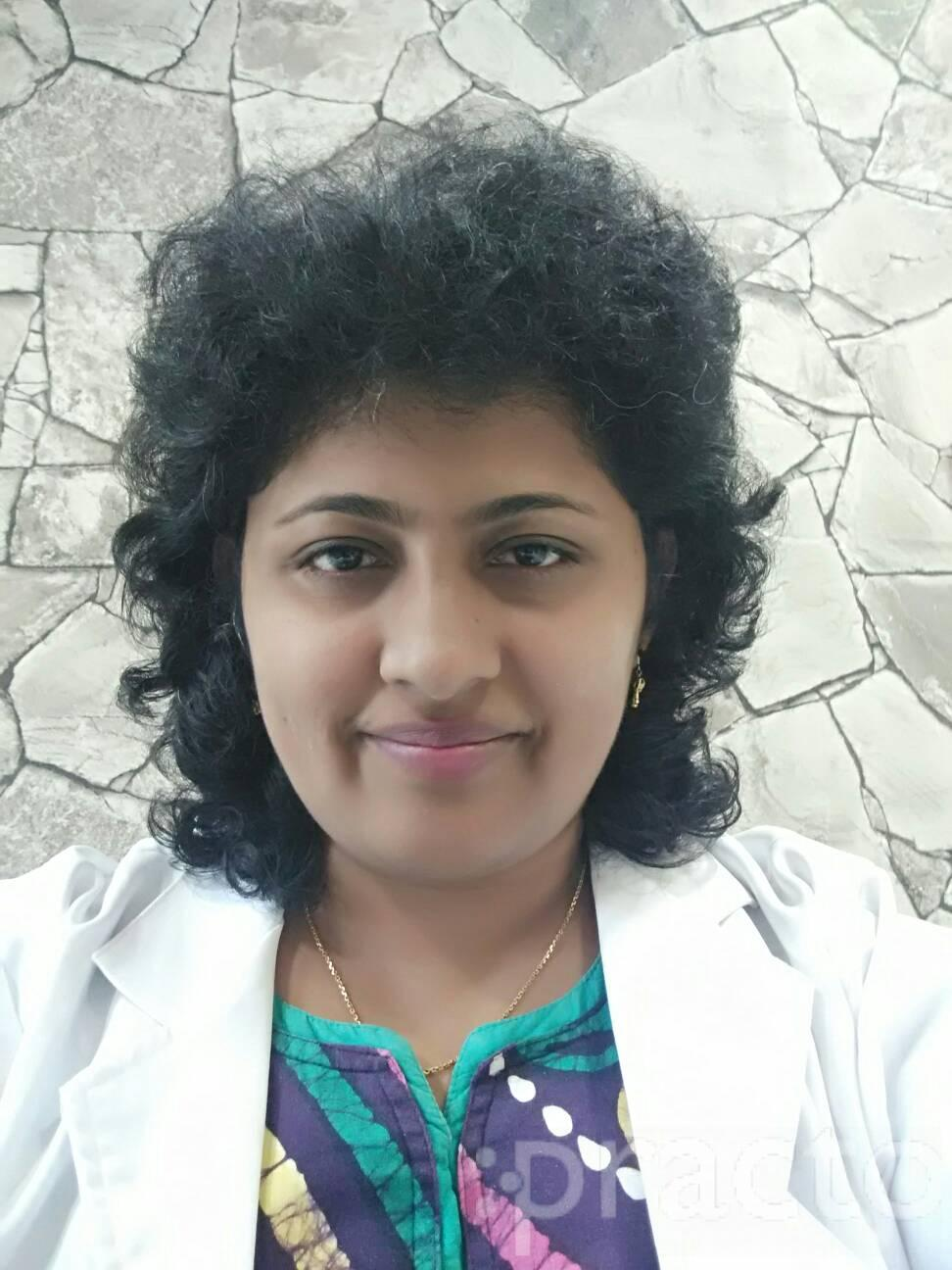 Dr. Reena John - Dentist