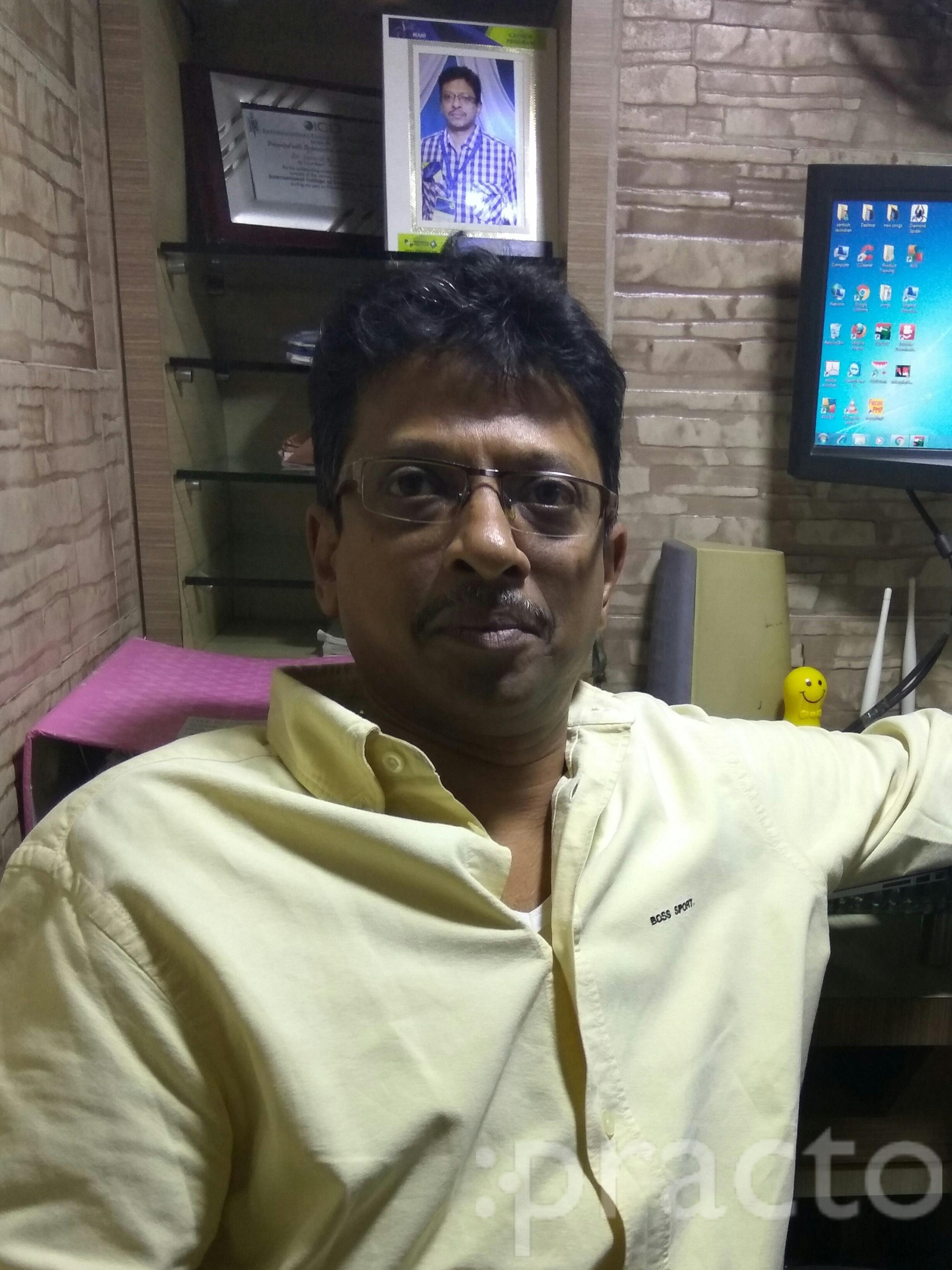 Dr. Santosh Ravindran - Dentist