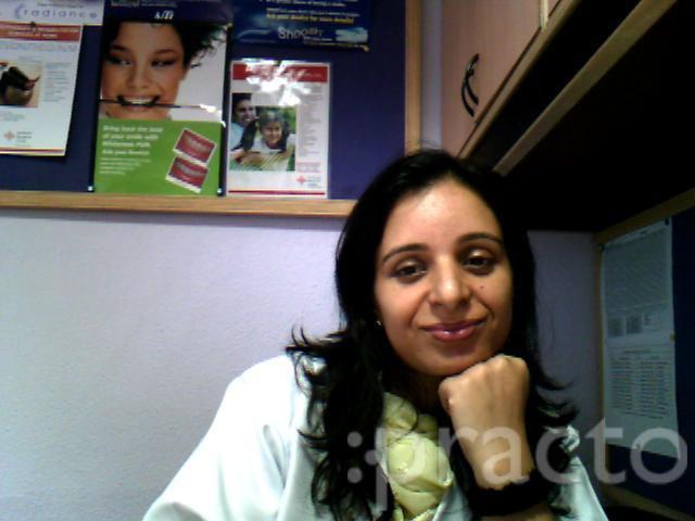 Dr. Suman N. Raina - Dentist