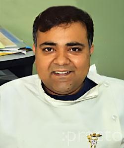 Dr. Tarun Ahuja - Dentist