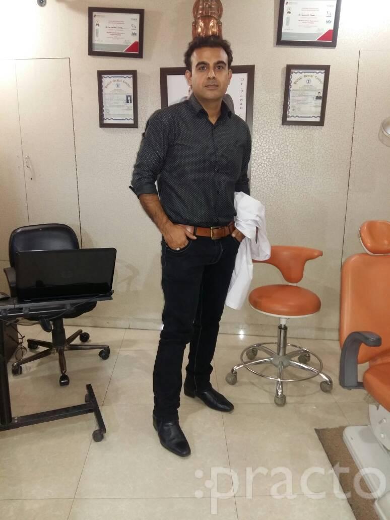 Dr. Tejinder Chopra - Dentist
