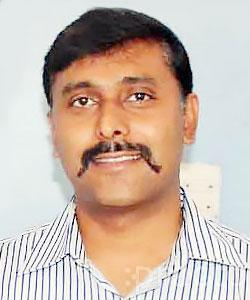 Dr. Tharun Malle Gowda - Dentist