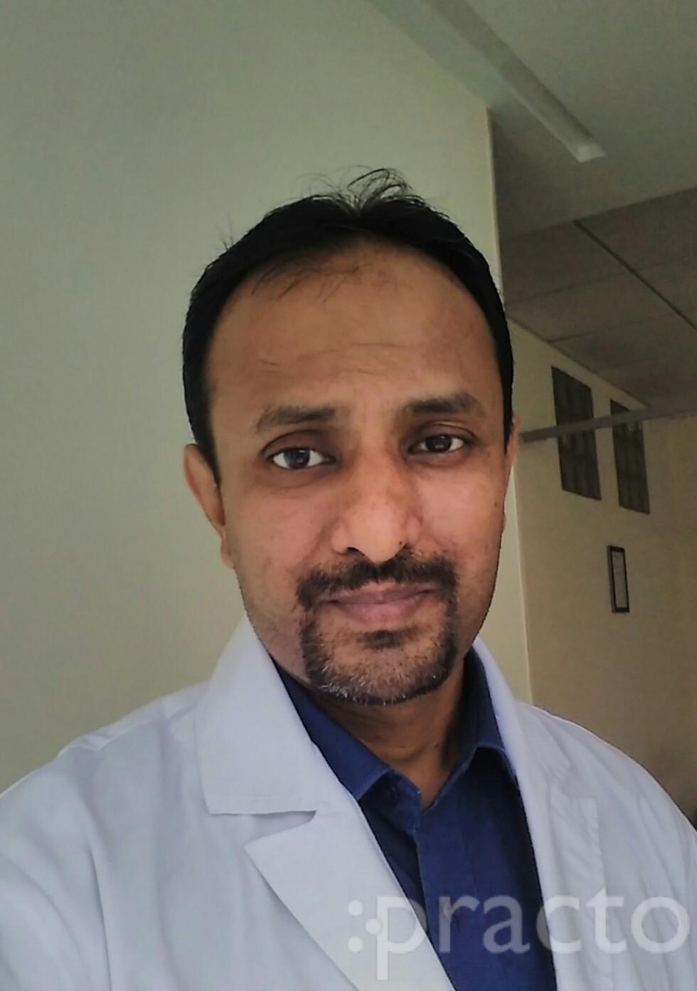 Dr. Umakantha Adiga - Pediatrician