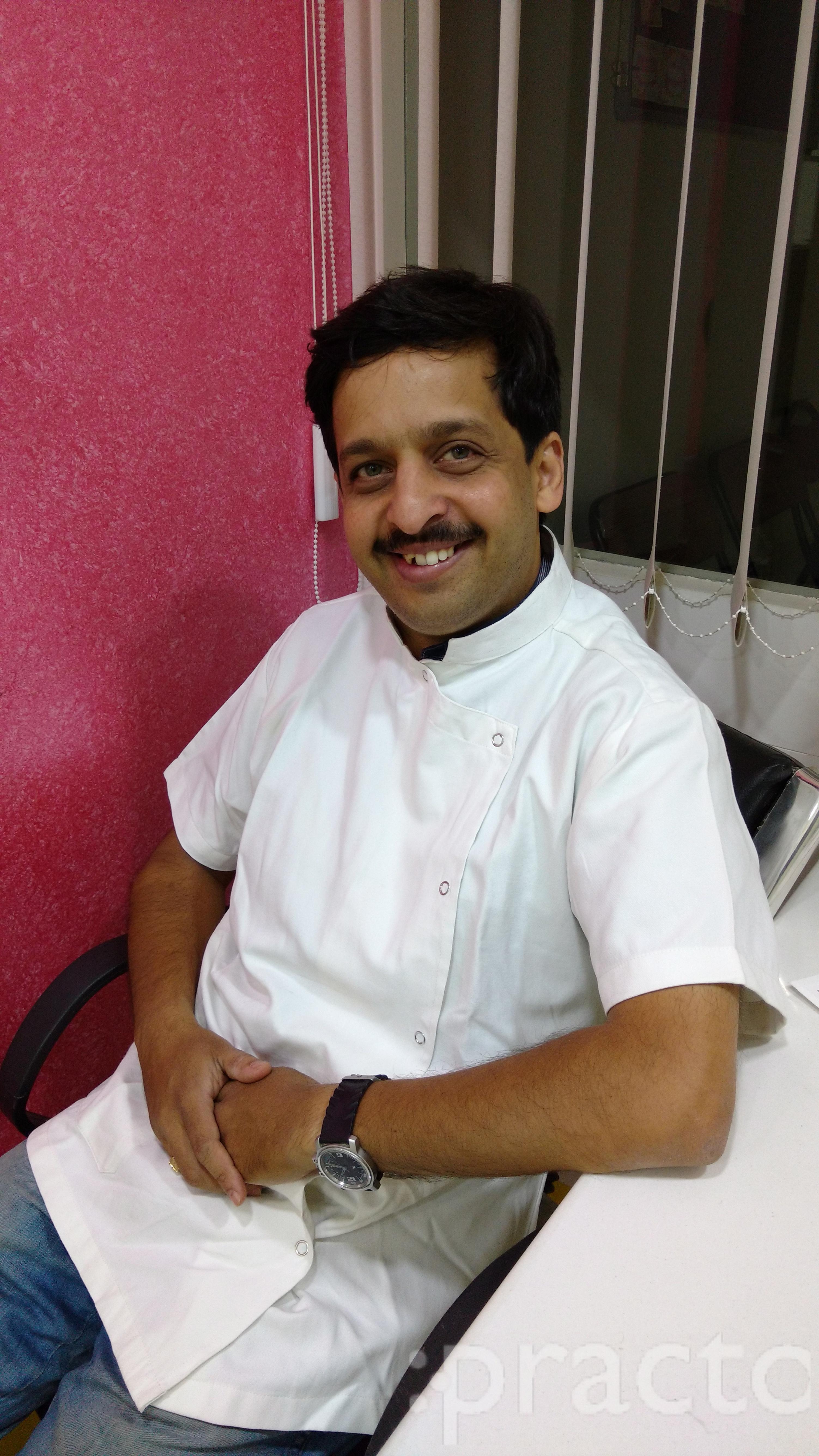 Dr. Unmesh Karmarkar - Dentist