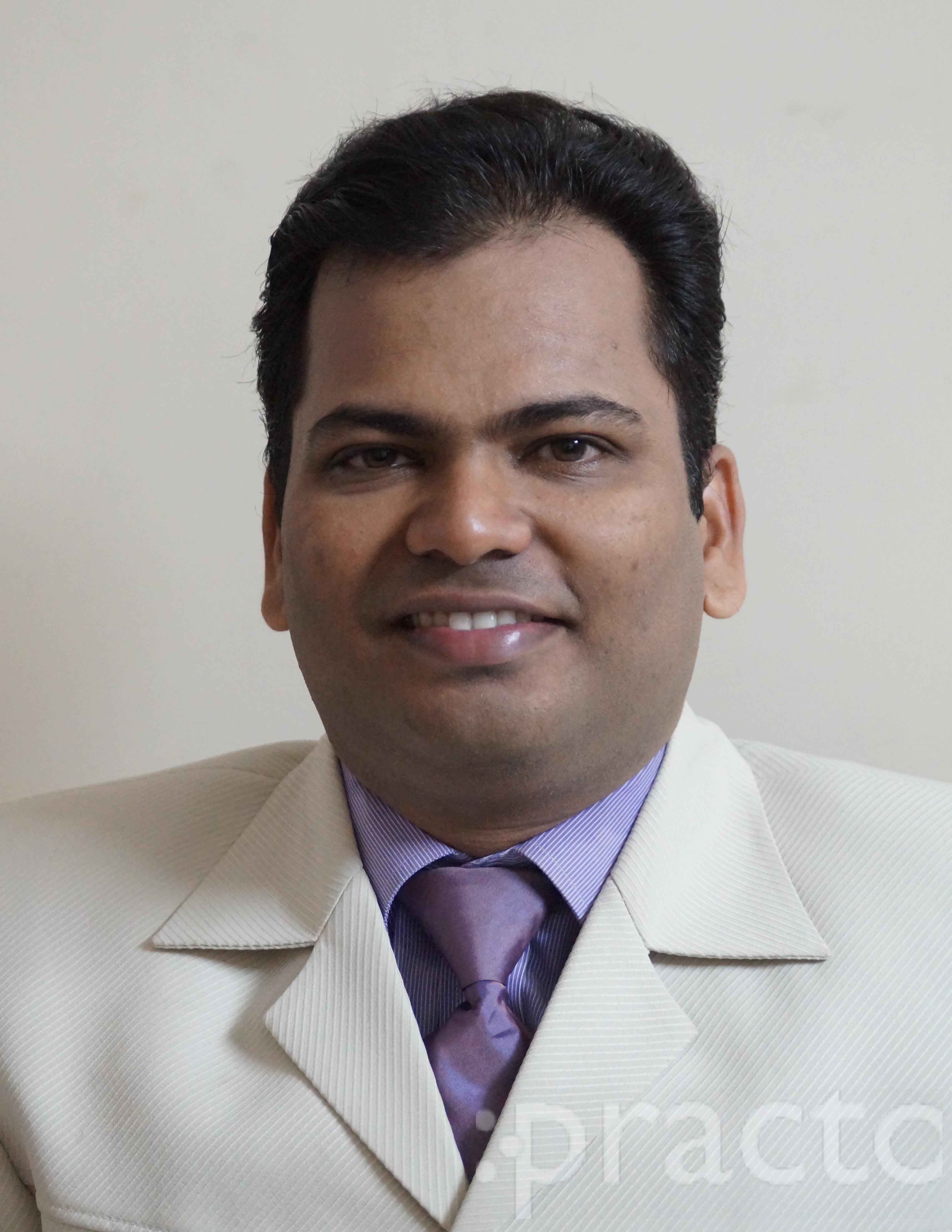Dr. Girish Shetake - Dentist