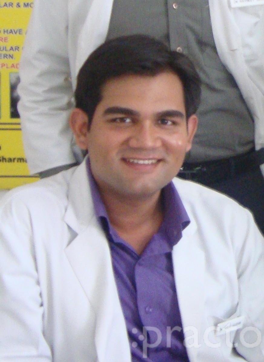 Dr. Tarun Kaushik - Dentist